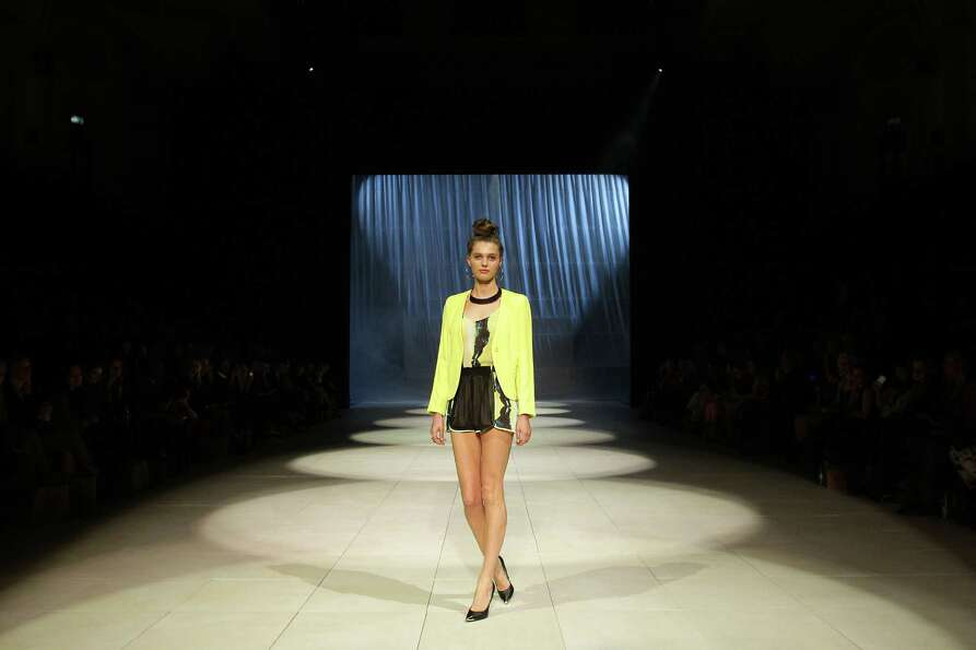A model showcases designs by Cotton On on the catwalk.