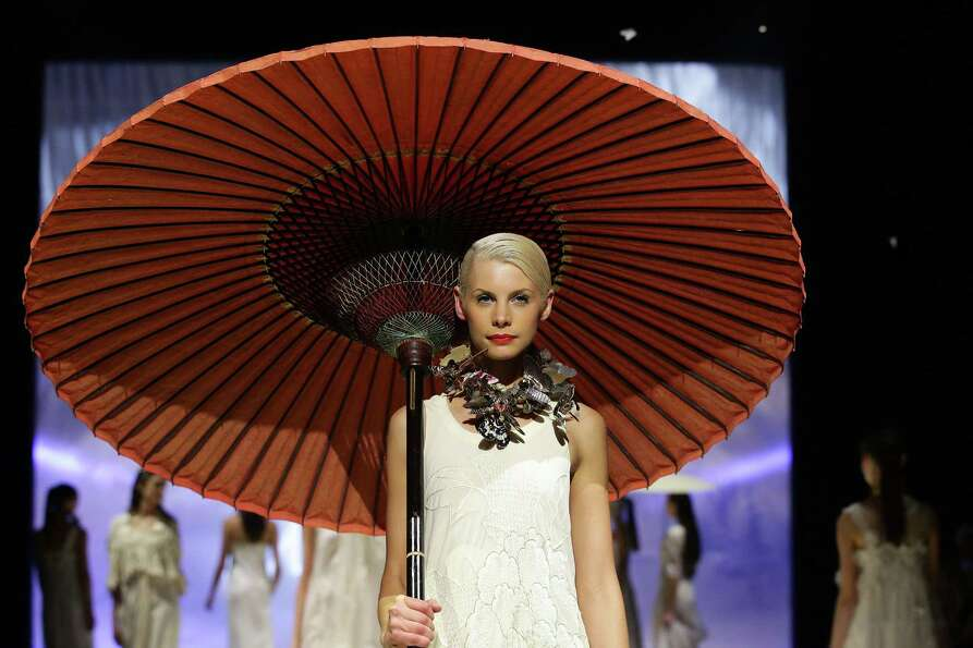A model showcases designs by Akira on the catwalk during the Fashion Week Australia Review presented