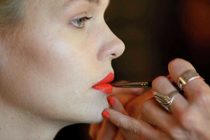 A model prepares backstage ahead of the Whitney Eve show.