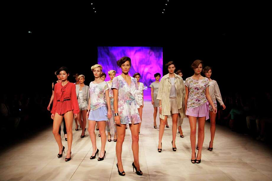 Models showcase designs by Whitney Eve on the catwalk. Photo: Lisa Maree Williams, Getty Images / 2012 Getty Images
