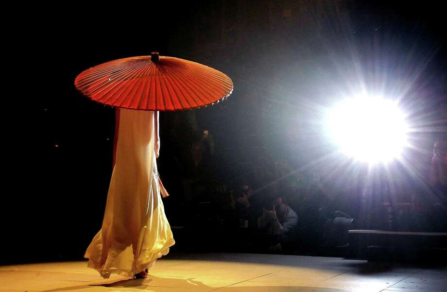A model showcases designs by Akira on the catwalk. Photo: Graham Denholm, Getty Images / 2012 Getty Images