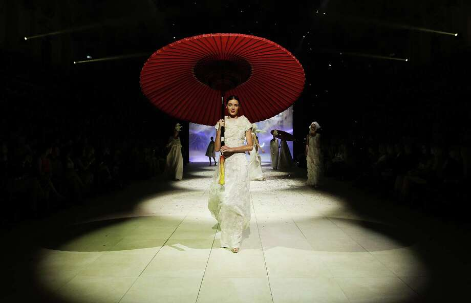 A model showcases designs by Akira on the catwalk. Photo: Don Arnold, Getty Images / 2012 Getty Images