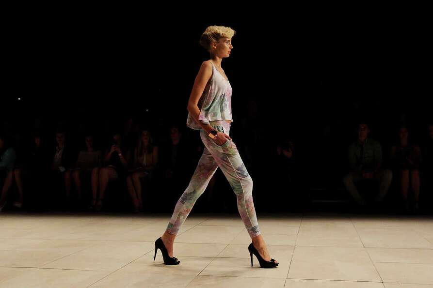A model showcases designs by Whitney Eve on the catwalk.