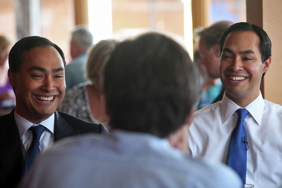 Mayor Julian Castro, right, and his brother, Congressional candidate Joaquin Castro, left, are interviewed by CBS News National Correspondent Lee Cowan as they tape a segment for the CBS Evening News at Rosario's in San Antonio on Friday, August 24, 2012. The segment will air the night Castro gives the keynote speech at the Democratic National Convention, Photo: Lisa Krantz, San Antonio Express-News / San Antonio Express-News