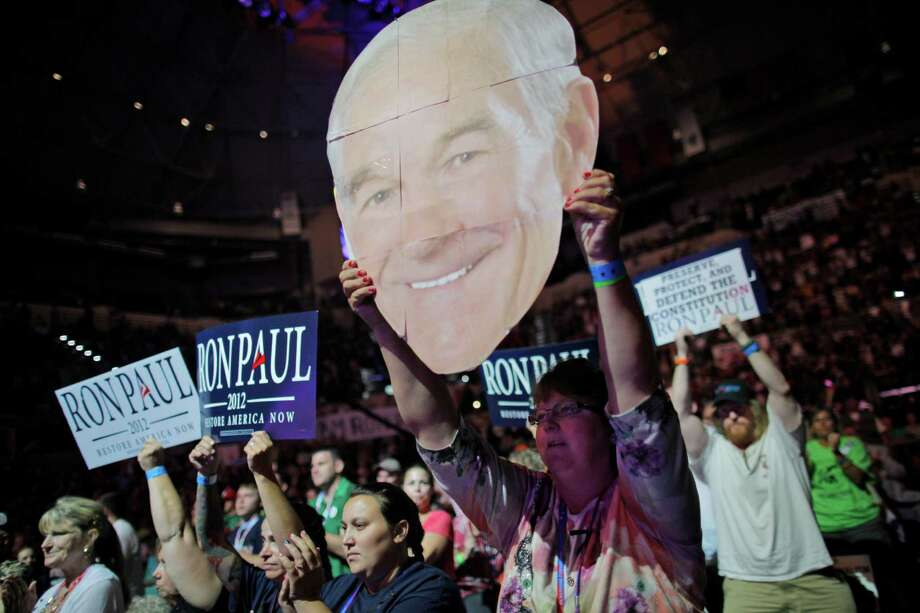 Mary White of Rathdrum, Idaho, shows her support for Rep. Ron Paul, R-Texas, at a rally at the University of South Florida Sun Dome on the sidelines of the Republican National Convention in Tampa, Fla., on Sunday, Aug. 26, 2012. Photo: Charles Dharapak