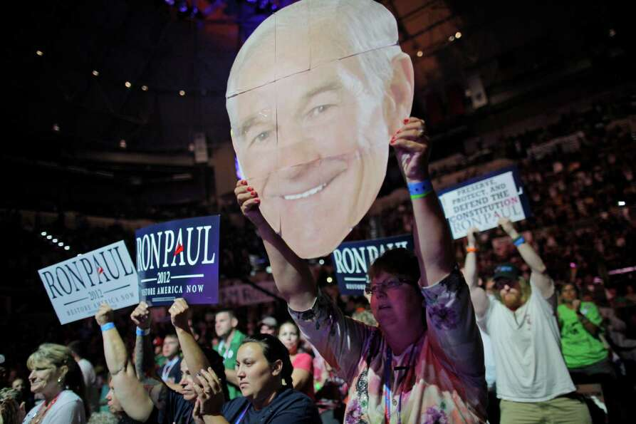Mary White of Rathdrum, Idaho, shows her support for Rep. Ron Paul, R-Texas, at a rally at the Unive