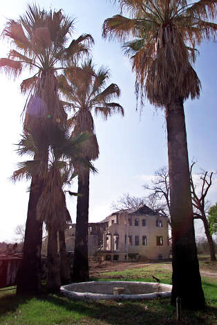Exterior view of the Hot Wells Hotel with palms in front. Kin Man Hui/staff Photo: Kin Man Hui, En / en