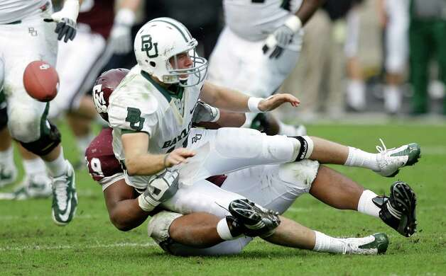 Baylor quarterback Nick Florence fumbles after being hit by Texas A&M lineman Eddie Brown during a 2009 game. Photo: Brett Coomer, Houston Chronicle / Houston Chronicle