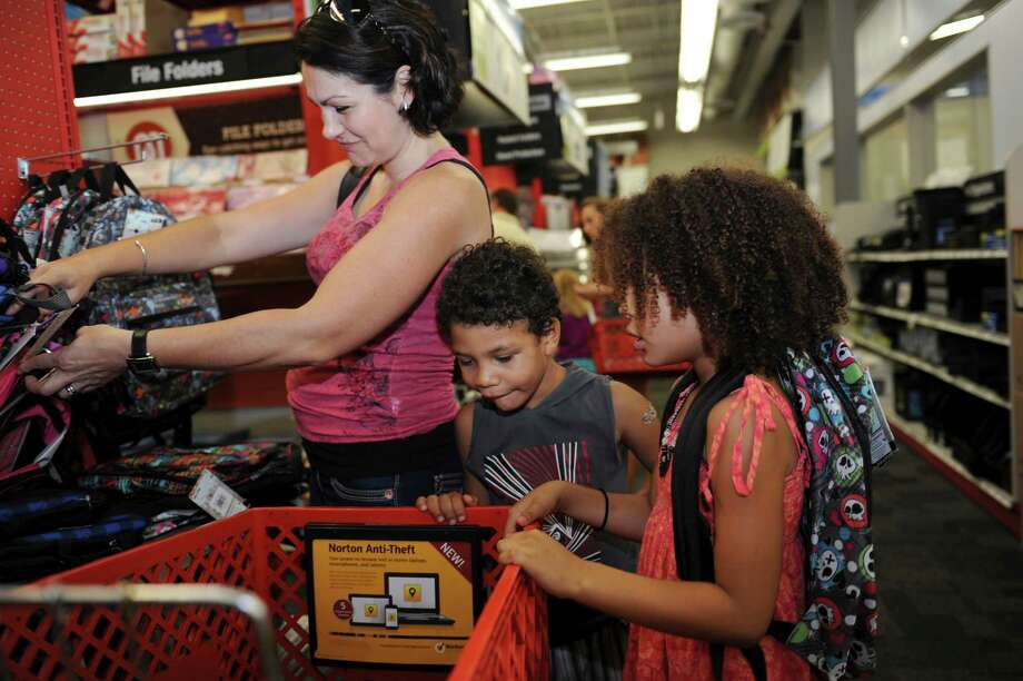 Kristen Brown of Greenwich, shopping with her children Aaliyah, 6, and Mekai, 4, at Staples in Old Greenwich Sunday, Aug. 26, 2012. The last weekend before the Labor Day weekend is traditionally the time when parents and their children hunt down deals in stores for back-to-school supplies and it was no different Sunday as parents prepared their children for the coming school year. Photo: Helen Neafsey / Greenwich Time