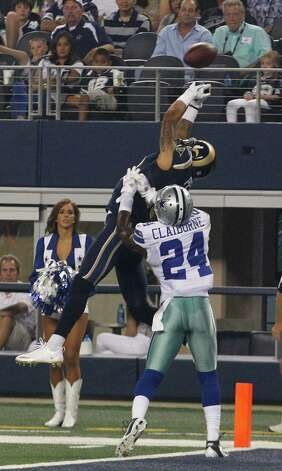 Dallas Cowboys cornerback Morris Claiborne (24) breaks up a pass meant for St. Louis Rams wide receiver Austin Pettis (18) during the second half of a preseason NFL football game, Saturday, Aug. 25, 2012 in Arlington, Texas. (AP Photo/LM Otero) Photo: LM Otero, Associated Press / AP