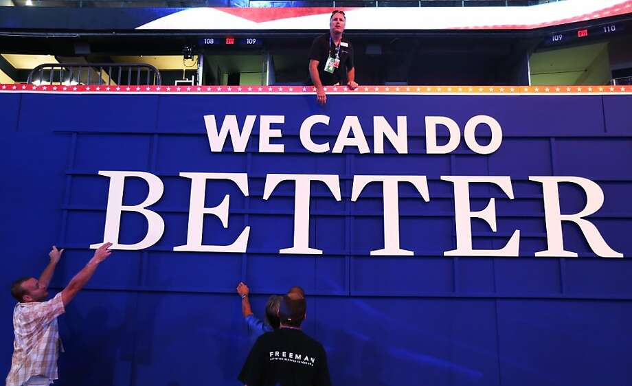 "Workers hang a campaign sign that reads ""We Can Do Better"" ahead of the Republican National Convention at the Tampa Bay Times Forum on August 26, 2012 in Tampa, Florida. The RNC is scheduled to convene on August 27 and will hold its first session on August 28 as Tropical Storm Isaac threatens disruptions due to its proximity to the Florida peninsula.  (Photo by Scott Olson/Getty Images) Photo: Scott Olson, Getty Images"