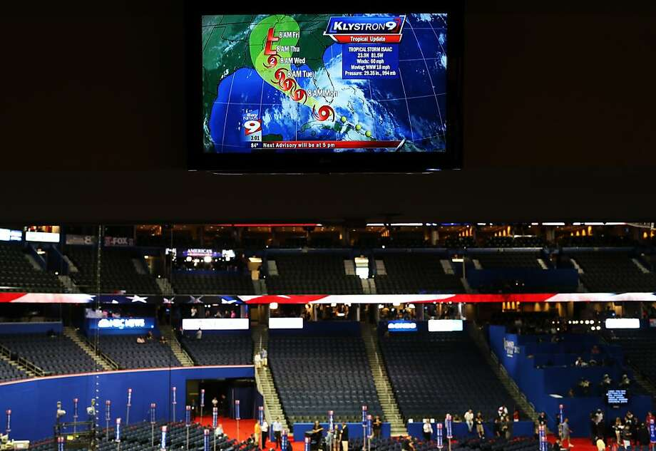 News reports for Tropical Storm Isaac appears on a screen above the floor ahead of the Republican National Convention at the Tampa Bay Times Forum on August 26, 2012 in Tampa, Florida. The RNC is scheduled to convene on August 27 and will hold its first session on August 28 as Tropical Storm Isaac threatens disruptions due to its proximity to the Florida peninsula.  (Photo by Spencer Platt/Getty Images) Photo: Spencer Platt, Getty Images