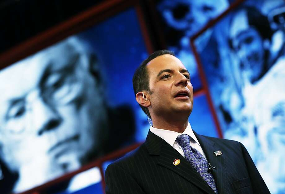 RNC Chairman Reince Priebus stands in front of a tribute displayed on stage for recently deceased NASA astronaut Neil Armstrong ahead of the Republican National Convention at the Tampa Bay Times Forum on August 26, 2012 in Tampa, Florida. The RNC is scheduled to convene on August 27 and will hold its first session on August 28 as Tropical Storm Isaac threatens disruptions due to its proximity to the Florida peninsula.  (Photo by Win McNamee/Getty Images) Photo: Win McNamee, Getty Images