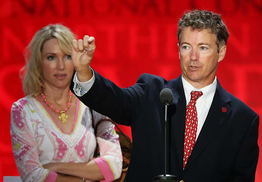 U.S. Sen. Rand Paul (R-KY) stands at the podium with his wife Kelley Paul on stage ahead of the Republican National Convention at the Tampa Bay Times Forum on August 26, 2012 in Tampa, Florida. The RNC is scheduled to convene on August 27 and will hold its first full-day session on August 28 as Tropical Storm Isaac threatens disruptions due to its proximity to the Florida peninsula.  (Photo by Mark Wilson/Getty Images) Photo: Mark Wilson, Getty Images