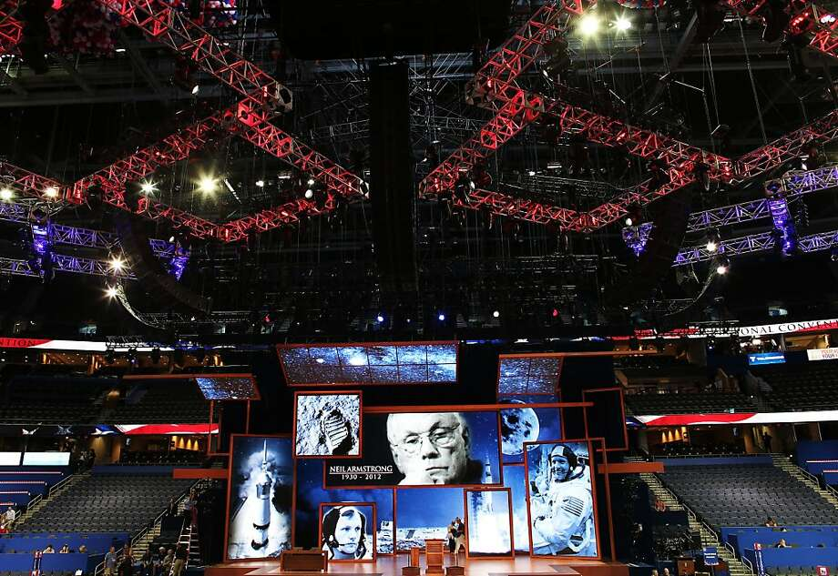 A tribute is displayed on stage for recently deceased NASA astronaut Neil Armstrong who was born in Wapakoneta, Ohio ahead of the Republican National Convention at the Tampa Bay Times Forum on August 26, 2012 in Tampa, Florida. The RNC is scheduled to convene on August 27 and will hold its first session on August 28 as Tropical Storm Isaac threatens disruptions due to its proximity to the Florida peninsula.  (Photo by Win McNamee/Getty Images) Photo: Win McNamee, Getty Images