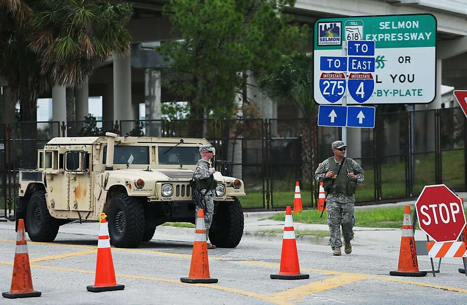 U.S. National Guard patrol in front of the Tampa Bay Times Forum ahead of the Republican National Convention on August 26, 2012 in Tampa, Florida. The RNC is scheduled to convene on August 27 and will hold its first session on August 28 as Tropical Storm Isaac threatens disruptions due to its proximity to the Florida peninsula.  (Photo by Scott Olson/Getty Images) Photo: Scott Olson, Getty Images