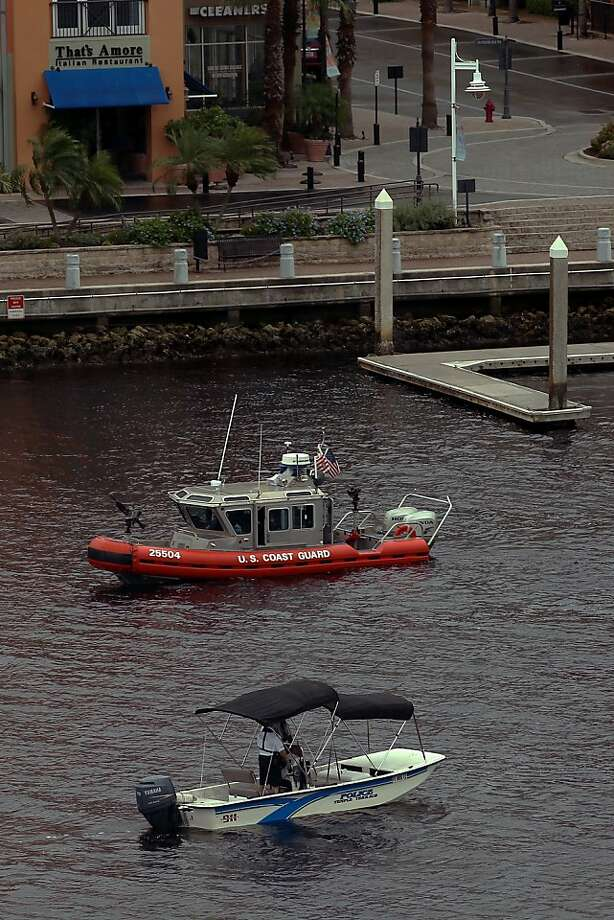 U.S. Coast Guard and police vessels patrol the waterways around the Tampa Bay Times Forum ahead of the Republican National Convention on August 26, 2012 in Tampa, Florida. The RNC is scheduled to convene on August 27 and will hold its first session on August 28 as Tropical Storm Isaac threatens disruptions due to its proximity to the Florida peninsula.  (Photo by Spencer Platt/Getty Images) Photo: Spencer Platt, Getty Images