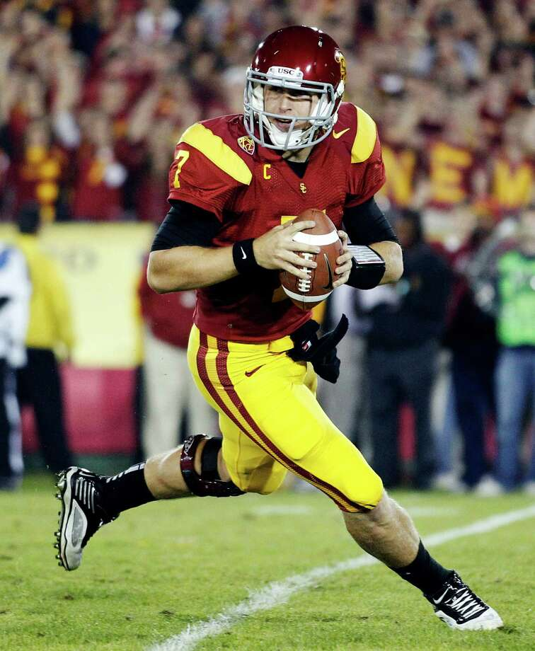 Southern California quarterback Matt Barkley rolls out of the pocket during an NCAA college football game against UCLA in Los Angeles on Nov. 26, 2011. Photo: Jae Hong, Associated Press / AP