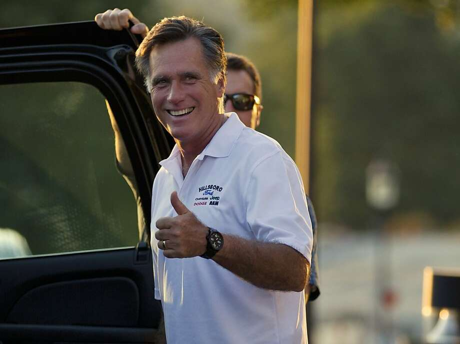 Republican presidential candidate, former Massachusetts Gov. Mitt Romney gives a thumbs up as he leaves Brewster Academy after finishing convention preparations for the day on Sunday, Aug. 26, 2012 in Wolfeboro, N.H.  (AP Photo/Evan Vucci) Photo: Evan Vucci, Associated Press
