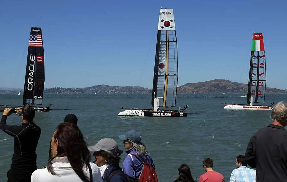 Spectators watch the conclusion of the America's Cup World Series racing from onshore in San Francisco's Marina. Photo: Carlos Avila Gonzalez, The Chronicle