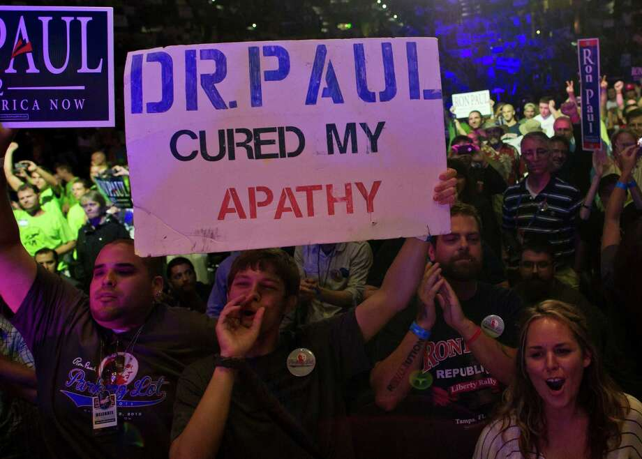 Supporters of US Republican presidential contender Ron Paul react during his speech at a rally at the Sun Dome of the University of South Florida in Tampa, Florida, on August 26, 2012. Thousands of Ron Paul supporters gathered in Sun Dome to show support for their candidate.     AFP PHOTO/MLADEN ANTONOVMLADEN ANTONOV/AFP/GettyImages Photo: MLADEN ANTONOV, AFP/Getty Images / AFP