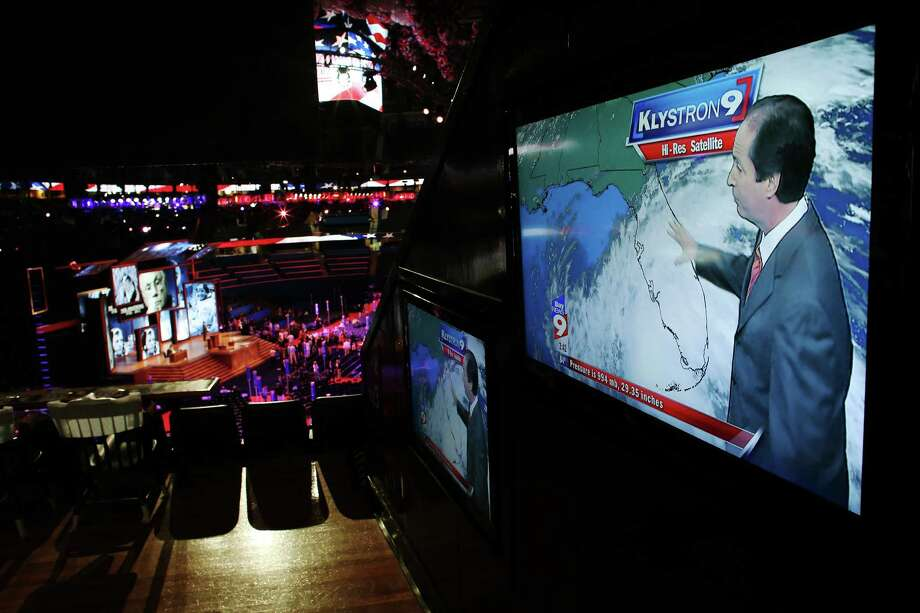 HURRICANE ISAAC:As the storm moved into the Gulf of Mexico and its track was not certain, the 2012 Republican National Convention was postponed a day in Tampa Bay, Fla., for safety reasons.  Above, news reports appear on screens inside the convention at the Tampa Bay Times Forum on Aug. 26, 2012.  Photo: Win McNamee, Getty Images / 2012 Getty Images