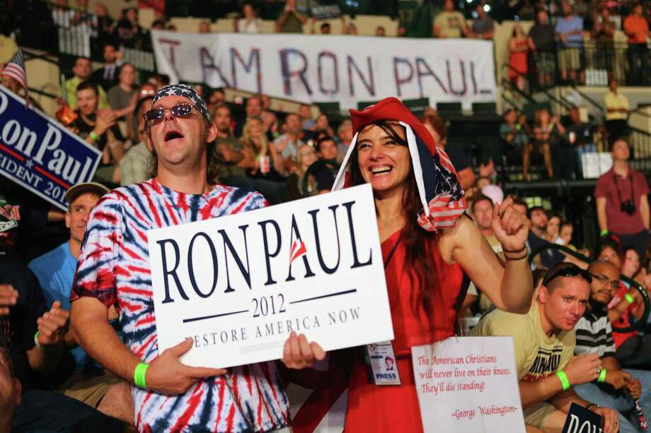 TAMPA, FL - AUGUST 26:  People cheer as they listen to speakers while waiting for former Republican presidential candidate U.S. Rep. Ron Paul (R-TX) to arrive to speak to them during a rally in the Sun Dome at the University of South Florida on August 26, 2012 in Tampa, Florida.   The rally was being held on the eve of the start of the Republican's nominating convention which is scheduled to convene on August 27 and will hold its first session on August 28 as Tropical Storm Isaac threatens disruptions due to its proximity to the Florida. Photo: Joe Raedle, Getty Images / 2012 Getty Images
