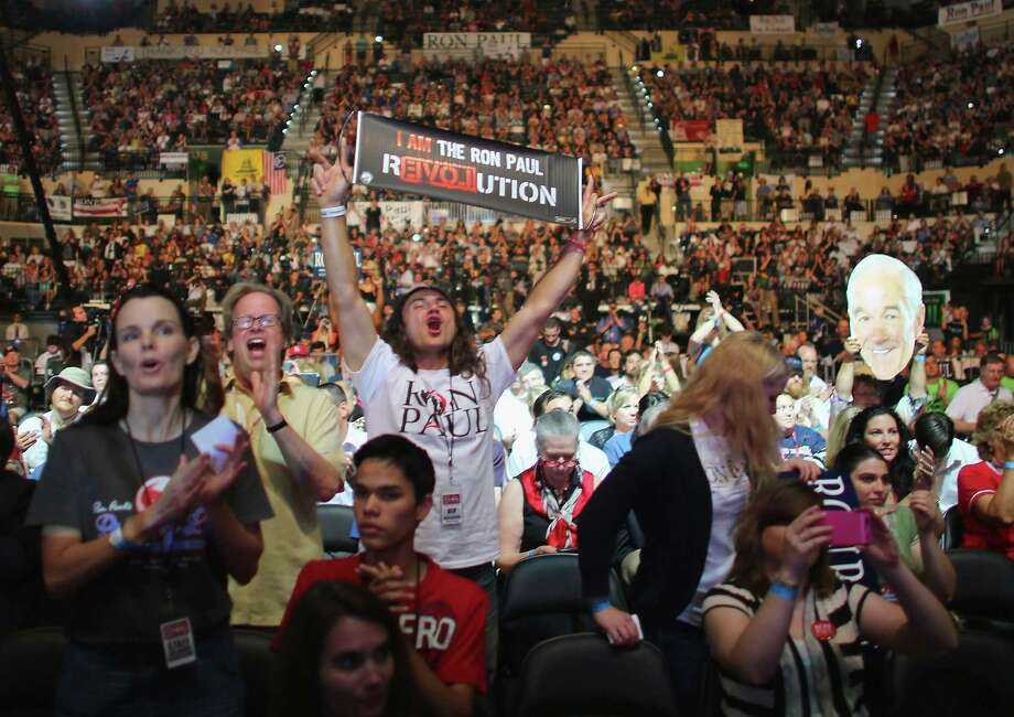 TAMPA, FL - AUGUST 26:  People cheer as they listen to speakers while waiting for former Republican presidential candidate Rep. Ron Paul (R-TX) to speak at a rally in the Sun Dome at the University of South Florida on August 26, 2012 in Tampa, Florida.   The rally was being held on the eve of the start of the Republican's nominating convention which will hold its first session on August 28. The convention was scheduled to start on August 27 but was pushed back one day as Tropical Storm Isaac threatens to hit the Tampa area. Photo: Joe Raedle, Getty Images / 2012 Getty Images