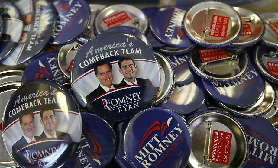 Republican presidential candidate and former Massachusetts Gov. Mitt Romney along with his running mate Republican vice presidential candidate, Rep. Paul Ryan, R-Wis., campaign buttons are displayed ahead of the Republican National Convention in Tampa, Fla., on Sunday, Aug. 26, 2012. (AP Photo/Jae C. Hong) Photo: Jae C. Hong, Associated Press