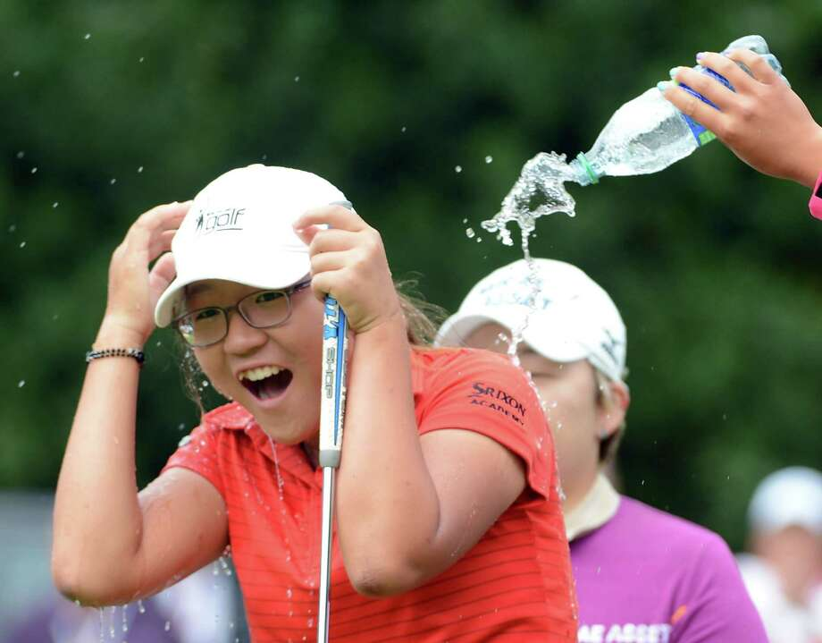 Water was a more appropriate beverage than champagne with which to celebrate Lydia Ko, 15, becoming the LPGA Tour's youngest winner. Photo: Harry How / 2012 Getty Images