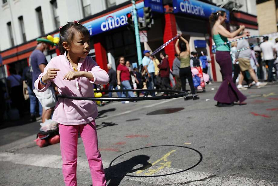 Alicia Chow, 7, plays with the hoop during the second annual Chinatown Sunday Streets in San Francisco, Calif. on Sunday, Aug 26, 2012. Photo: Sonja Och, The Chronicle