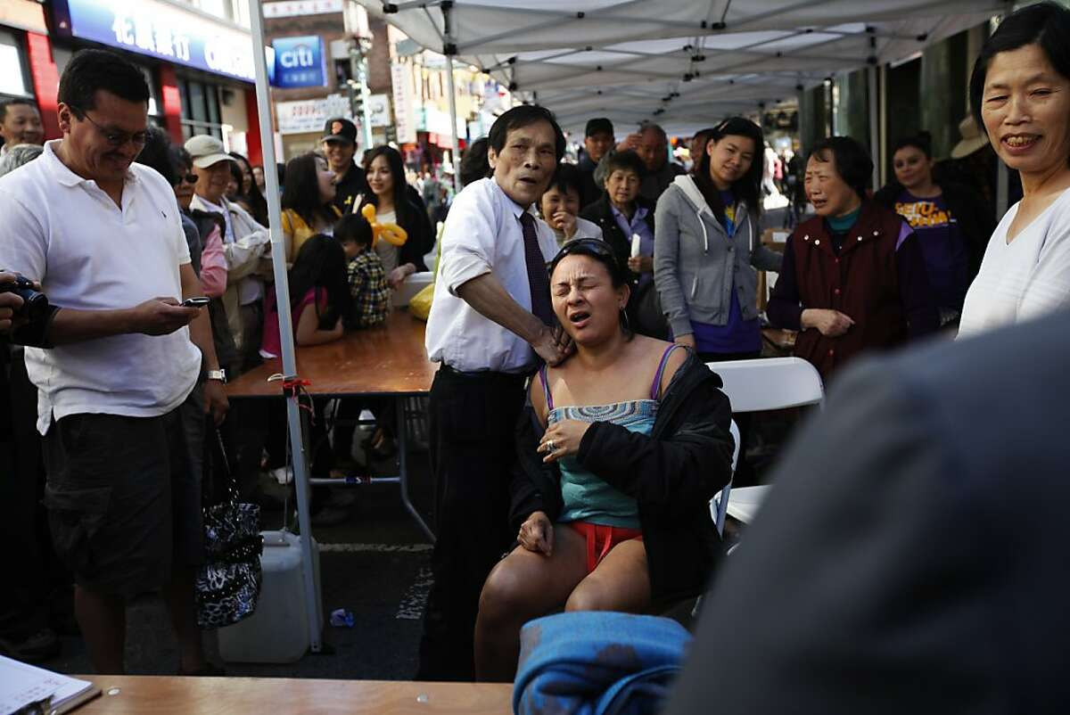 Diana Pacheco gets a massage at the second annual Chinatown Sunday Streets. San Francisco, Calif. on Sunday, Aug 26, 2012.