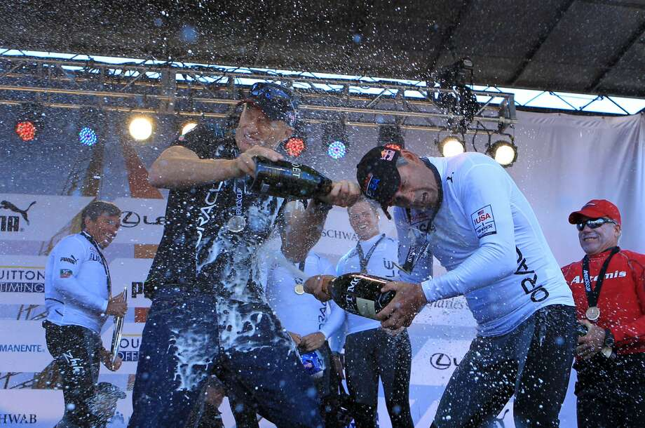 Oracle Team USA James Spithill and  Oracle Team USA Russell Coutts spray each other after winning second and first place of the  finale match racing of the America's Cup World Series on Sunday, August 26, 2012 in San Francisco, Calif.