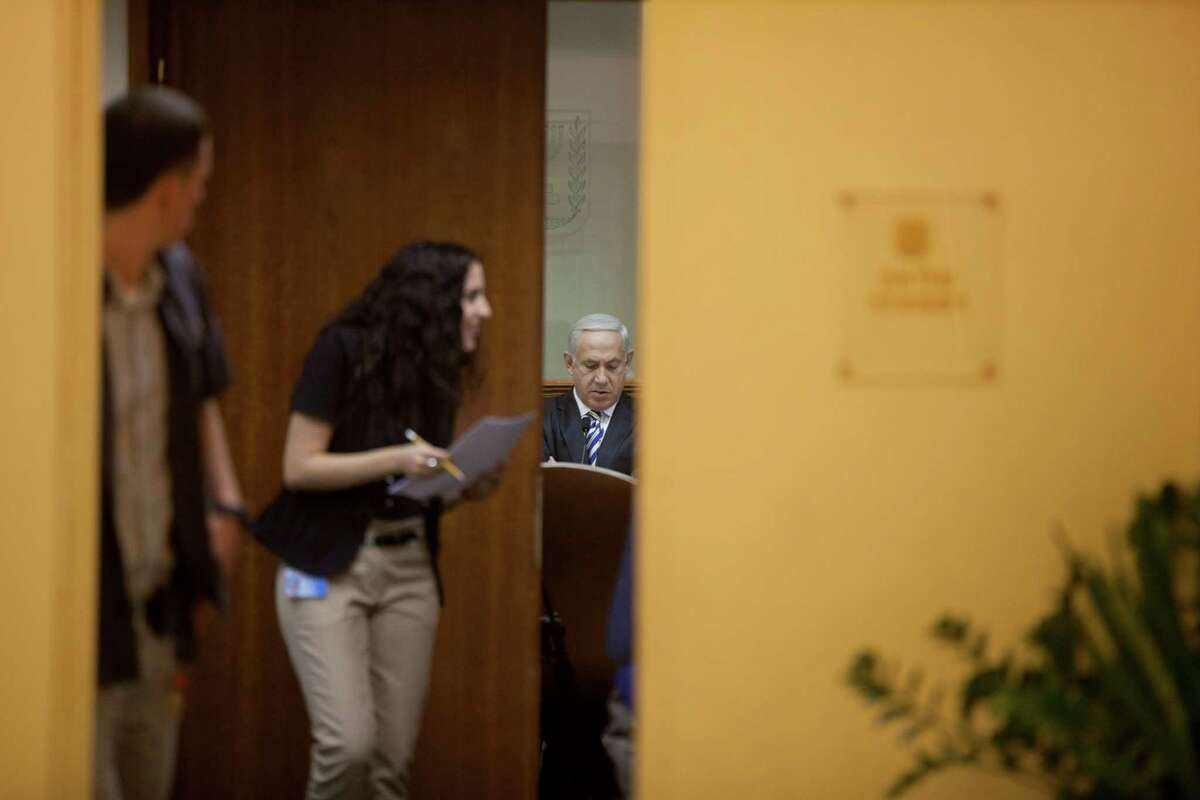 Israeli Prime Minister Benjamin Netanyahu, right, heads the weekly cabinet meeting in the prime minister's office in Jerusalem, Israel, August 26, 2012. (AP Photo/Uriel Sinai/Getty Images, Pool)