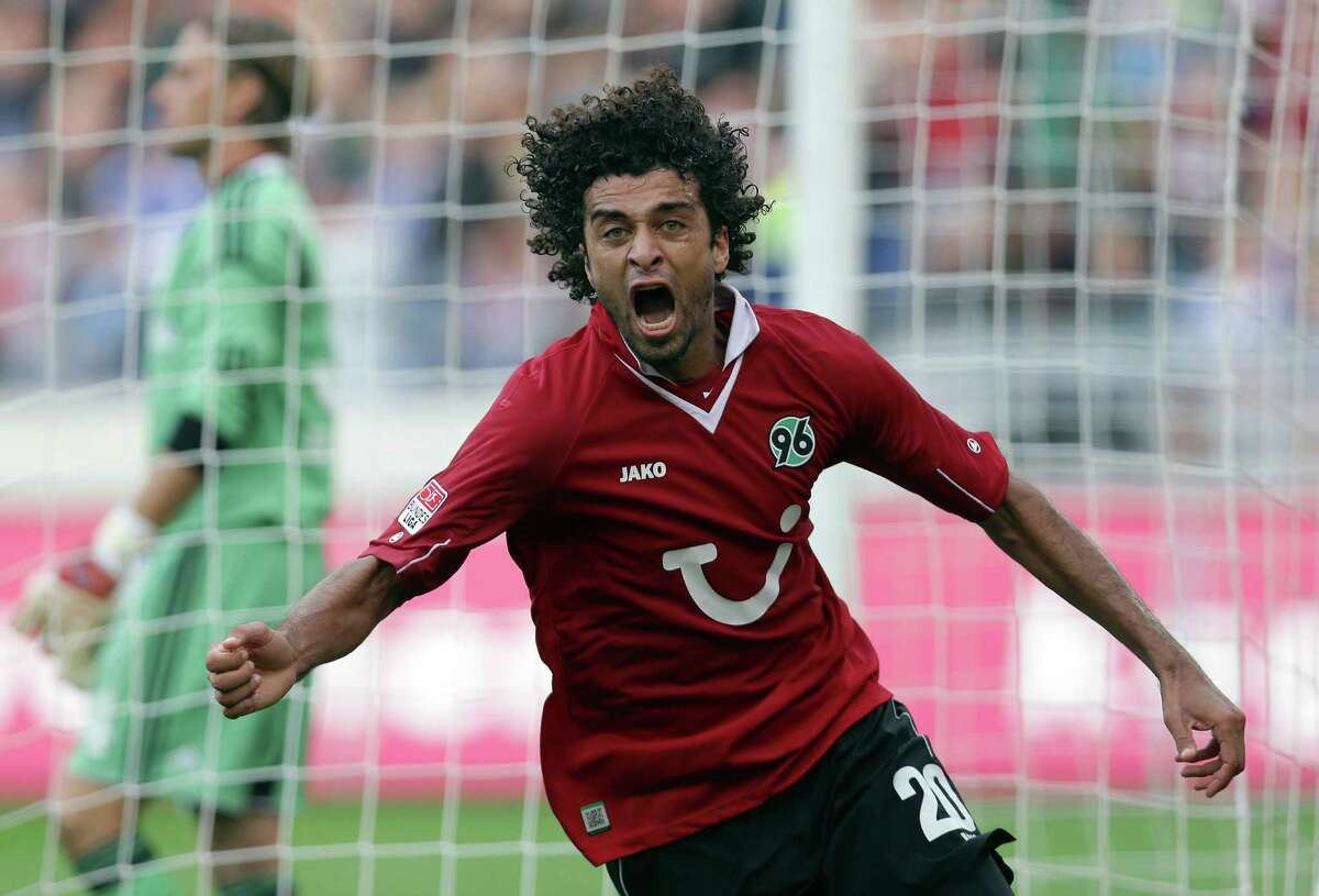 Hannover's Felipe of Brazil celebrates scoring his side's first goal during the German first division Bundesliga soccer match between Hannover 96 and FC Schalke 04 in Hannover, Germany, Sunday, Aug. 26, 2012. (AP Photo/Michael Sohn) - NO MOBILE USE UNTIL 2 HOURS AFTER THE MATCH, WEBSITE USERS ARE OBLIGED TO COMPLY WITH DFL-RESTRICTIONS, SEE INSTRUCTIONS FOR DETAILS -