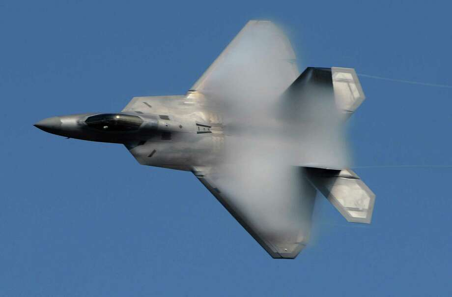 The F-22 Raptor fighter jet is the Air Force's prized warplane. But some stay it has a dark impact on its pilots, including blackouts and disorientation, despite studies claiming previous issues had been fixed. Photo: Bill Roth / The Anchorage Daily News