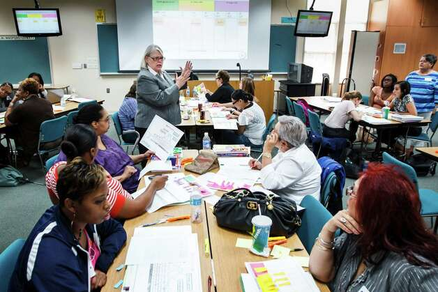Dr. Regina Gooden, center, teaches a class of HISD teachers during a professional development program at the Neuhaus Education Center, Wednesday, Aug. 22, 2012, in Houston. ( Michael Paulsen / Houston Chronicle ) Photo: Michael Paulsen / © 2012 Houston Chronicle