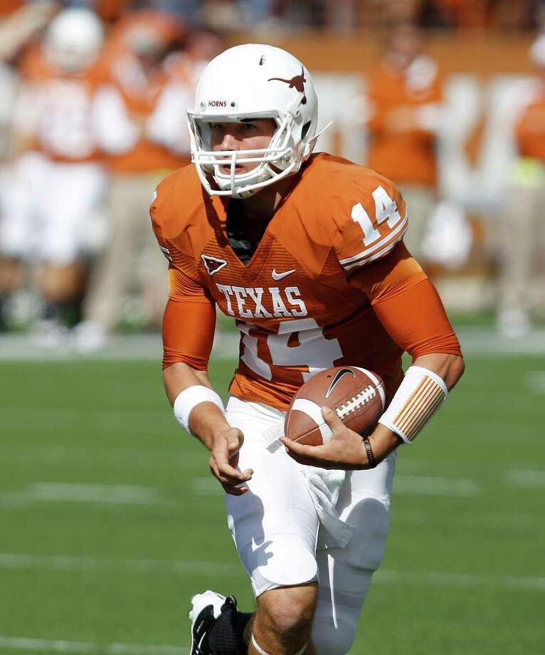 Texas'  David Ash during the first quarter of an NCAA college football game against Texas Tech, Saturday, Nov. 5, 2011, in Austin, Texas. (AP Photo/Eric Gay) Photo: Eric Gay / AP