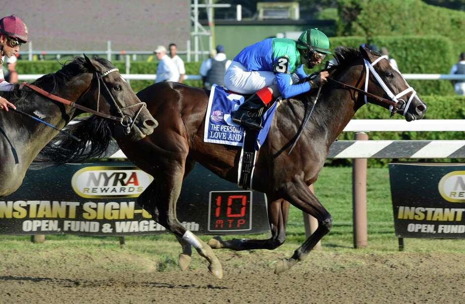 Love and Pride with jockey John Velazquez stuns the field to win the Personal Ensign Stakes with a late charging but beaten favorite Royal Delta with jockey Mike Smith coming up her shoulder at the Saratoga Race Course  in Saratoga Springs, N.Y. Aug. 25, 2012.   (Skip Dickstein/Times Union) Photo: Skip Dickstein