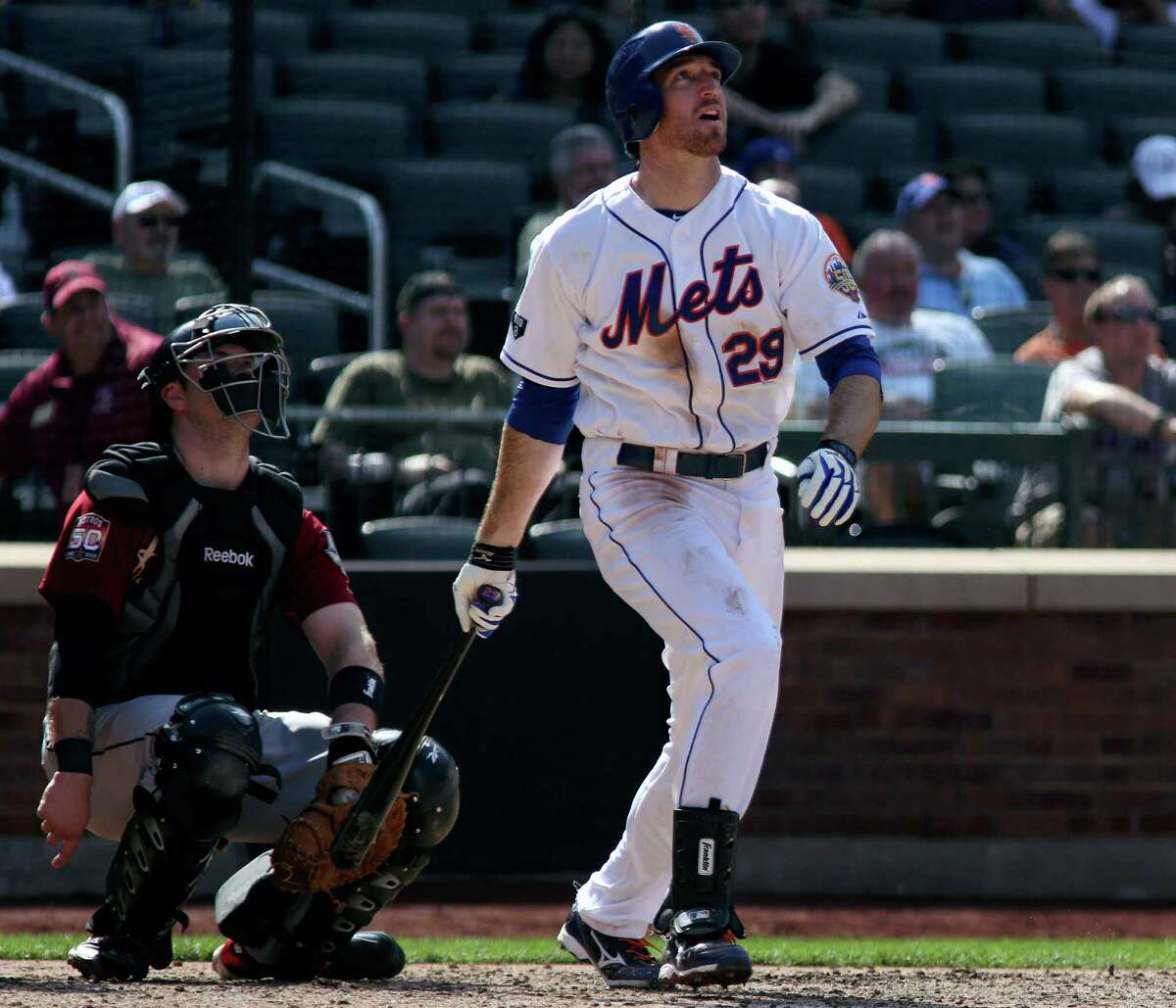 New York Mets' Ike Davis, right, watches his game-winning home run in the ninth inning of a baseball game against the Houston Astros at Citi Field in New York, Sunday, Aug. 26, 2012. Astros catcher Chris Snyder, left, looks on. (AP Photo/Craig Ruttle)
