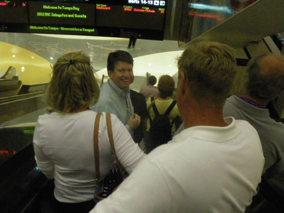 Former New York gubernatorial candidate John Faso chats with Columbia County Republican Chairman Greg Fingar as the two arrive at Tampa International Airport Sunday, Aug. 26, 2012, for the Republican National Convention. (Jimmy Vielkind/Times Union)