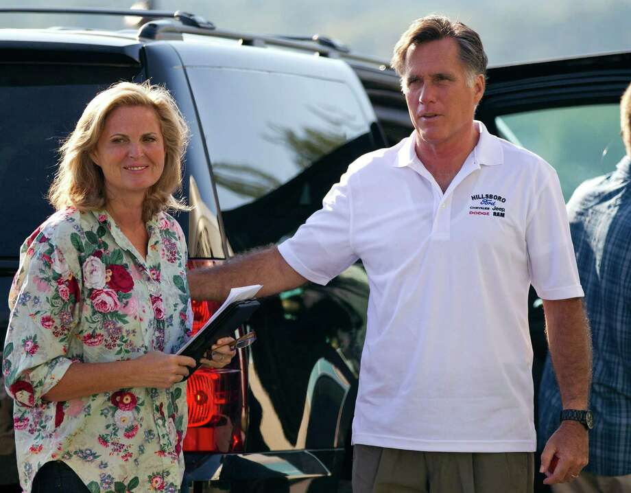 Republican presidential candidate, former Massachusetts Gov. Mitt Romney and his wife Ann arrive at Brewster Academy for convention preparations on Sunday, Aug. 26, 2012 in Wolfeboro, N.H.  (AP Photo/Evan Vucci) Photo: Evan Vucci / AP