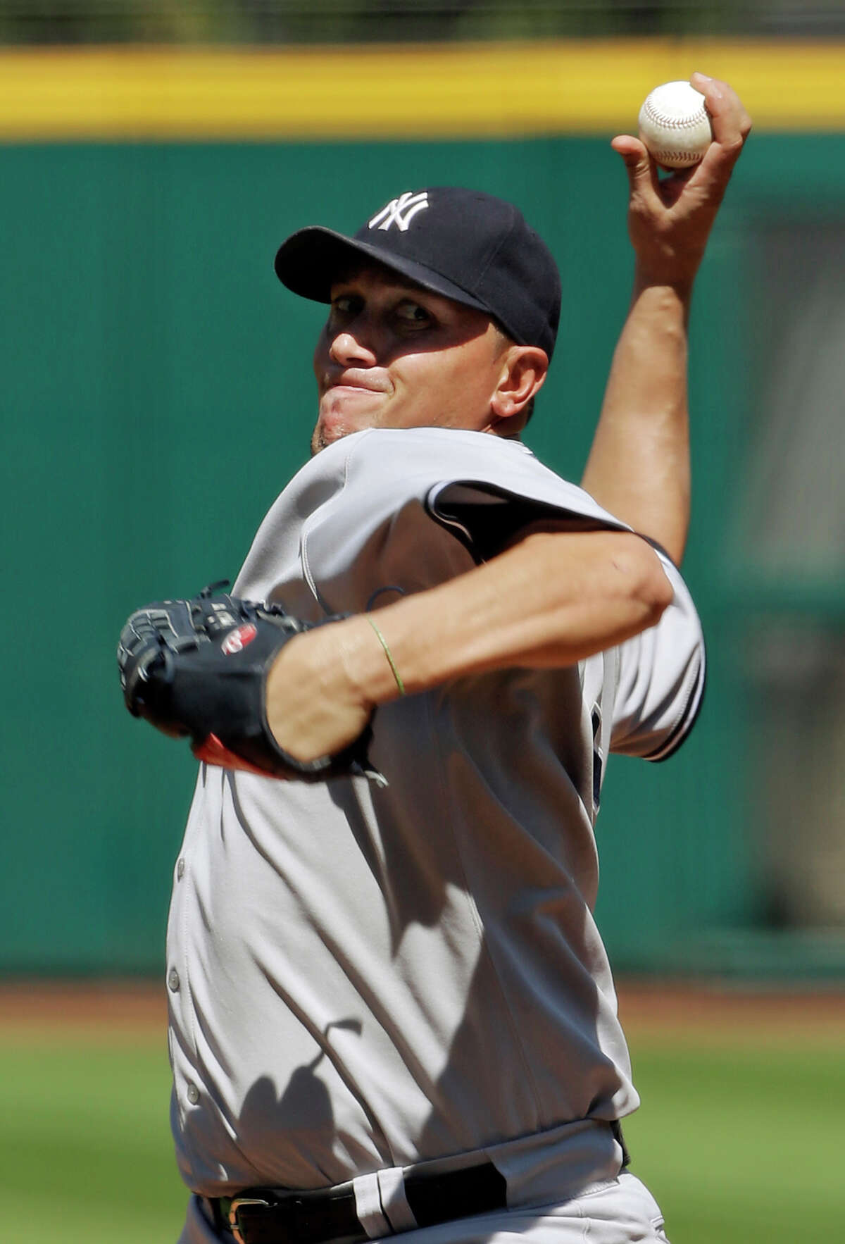 New York Yankees starting pitcher Freddy Garcia delivers against the Cleveland Indians in the first inning of a baseball game on Sunday, Aug. 26, 2012, in Cleveland. (AP Photo/Mark Duncan)