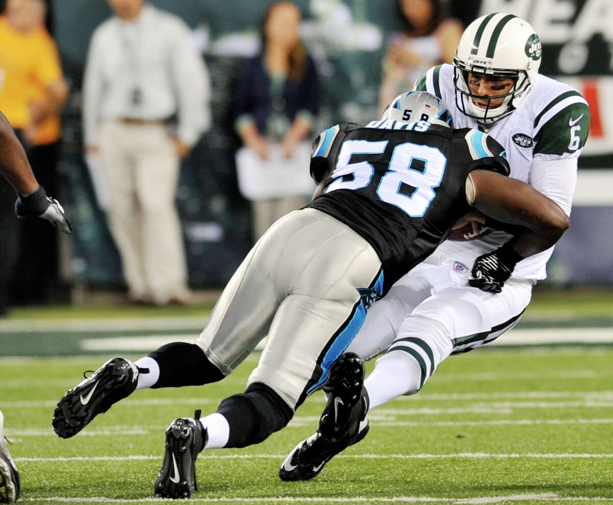 New York Jets quarterback Mark Sanchez (6) is sacked by Carolina Panthers linebacker Thomas Davis (58) during the first half of a preseason NFL football game, Sunday, Aug. 26, 2012, in East Rutherford, N.J. (AP Photo/Bill Kostroun)