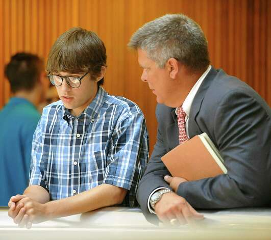 Tyler Lee Ramirez, 18, left, talks with his attorney Allen Parker, right, before entering Judge Walker's courtroom where he plead guilty to intoxication manslaughter and intoxication assault Monday July 30, 2012. He was accused of driving under the influence in the 3600 block of Cleveland Street in Groves in April 2011. He struck two teens, one on a bike and another on a skateboard, killing Jesse Sawyer and injuring Matthew English. Ramirez has been out on bond.   Dave Ryan/The Enterprise Photo: Dave Ryan