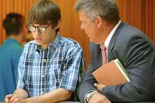 Tyler Lee Ramirez, 18, left, talks with his attorney Allen Parker, right, before entering Judge Walker's courtroom where he plead guilty to intoxication manslaughter and intoxication assault Monday July 30, 2012. He was accused of driving under the influence in the 3600 block of Cleveland Street in Groves in April 2011. He struck two teens, one on a bike and another on a skateboard, killing Jesse Sawyer and injuring Matthew English. Ramirez has been out on bond.   Dave Ryan/The Enterprise