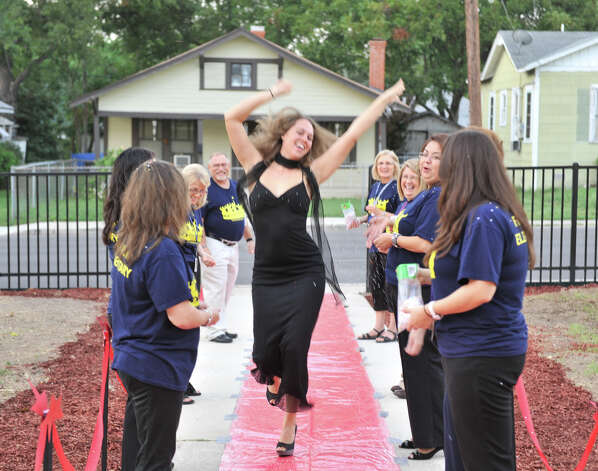 "Franklin Elementary School teacher Melissa Day dances up the ""red carpet"" prior to the arrival of students on the first day of school Monday. Some of the faculty dressed in evening wear and students were also interviewed over a public address system by Principal Eduardo Davila as a fun way to start the new school year Monday. Photo: Robin Jerstad/For The Express-News / ROBIN JERSTAD     210 254 6552"
