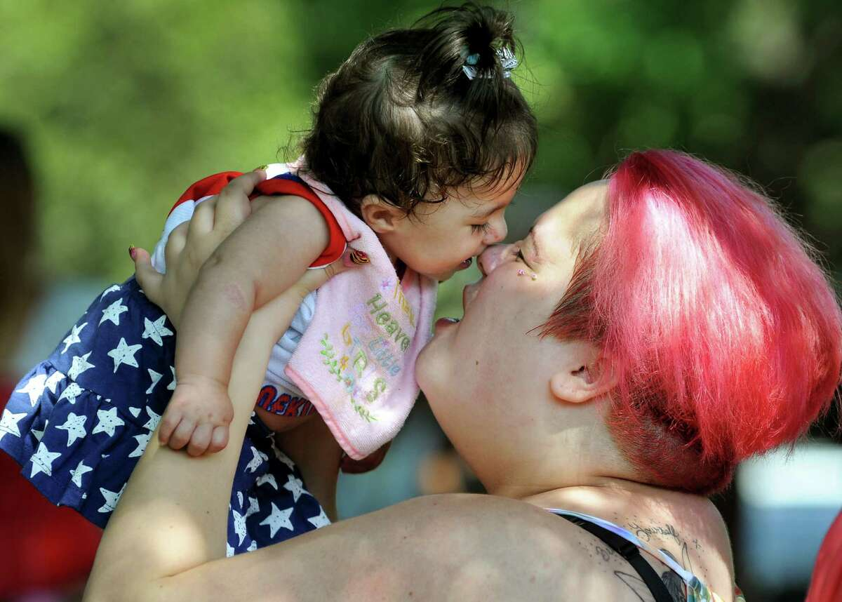 Puerto Rican Santana Rivera, 21, of Troy snuggles with her niece, Jaliciah Hernandez, 10 months, during the Albany Latin Fest on Saturday, Aug. 25, 2012, at Washington Park in Albany, N.Y. (Cindy Schultz / Times Union)