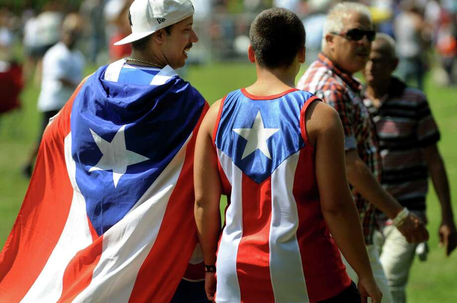 Ryan Perez, left, and Kyle Seniw, 15, both of Latham, show their Puerto Rican pride during the Albany Latin Fest on Saturday, Aug. 25, 2012, at Washington Park in Albany, N.Y. (Cindy Schultz / Times Union) Photo: Cindy Schultz, Albany Times Union / 00019020A
