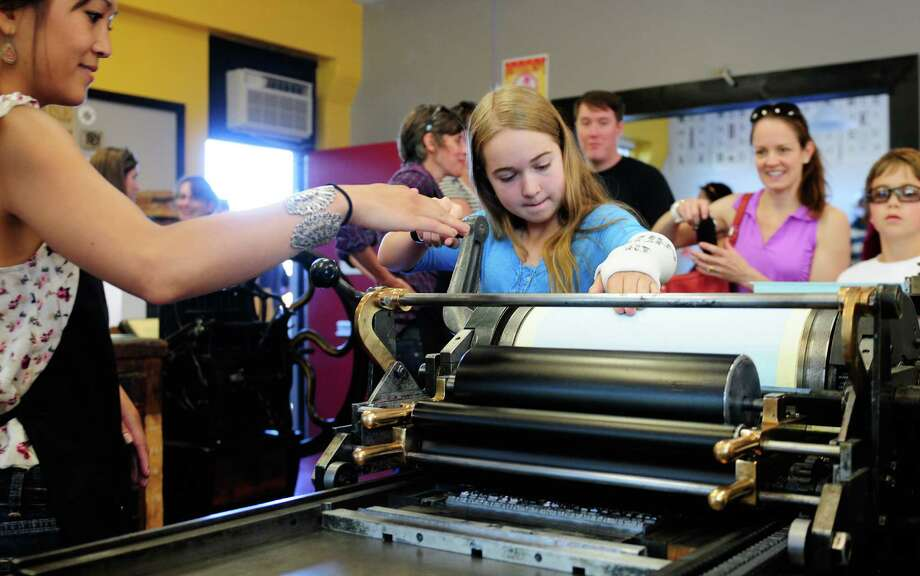 Madison Onsager, 13, makes her own print on a letterpress. Photo: LINDSEY WASSON / SEATTLEPI.COM